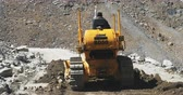 landslide : Excavator works on landslide site of remote mountain road in Himalaya region. Heavy machinery in Ladakh