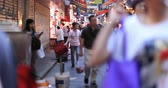 wan : Hong Kong street market urban scene. People walk and buy produce from local shops in Wan Chai district Stock Footage