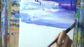 watercolor : The artist draws a picture paints Stock Footage