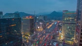 gündüz : Seoul City Gwanghwamun Traffic - Zooming time lapse of traffic and architecture in Gwanghwamun from day to night Stok Video