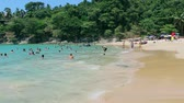 mar : PHUKET THAILAND CIRCA MAR 2015: Swimming at the beach in March 2015 in Phuket. Despite the holiday season there is still not very crowded places in Phuket