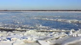 Ice drift on the big river, the sound of breaking ice