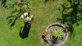 Gardener mows. View from height