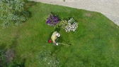 From height we see how gardener mows
