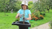 ajudante : Girl works in the garden using a garden shredder. Summer Stock Footage