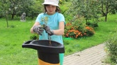 Garden garbage shredder. Girl is easily controlled with a mechanism 무비클립