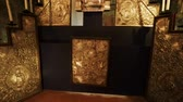 bakire : Beautiful tilt up of an altar in an ancient church.  Golden tones of the altar and candles