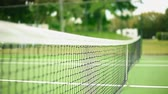 çiftler : Shot of a Net inside an empty Tennis Court on a beautiful day