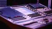 санки : Audio Mixing Console with Audio Engineer in front during Show