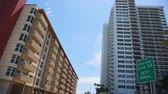 эт : EDITORIALCool daytime shot of buildings as you drive on Collins Ave. in Sunny Isles-Miami Стоковые видеозаписи