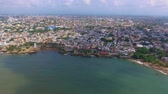 медовый месяц : Aerial shot of Caribbean island Dominican Republic with buildings and ocean in the back during the day