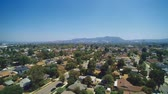 caído : Daytime Orbital aerial shot over North Hills, CA in the valley