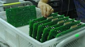 sorts : A worker sorts printed circuit boards Stock Footage
