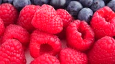 blueberry : Delicious raspberries and blueberries panorama macro Stock Footage