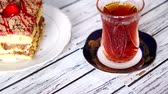 guloseima : cups of tea and Oriental sweets on the table Stock Footage