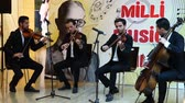 educador : Baku, Azerbaijan, 15 March 2017: orchestra of four men playing different instruments in the foyer of the theatre