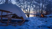 landscape : Winter camp at the lake with a bonfire 4k timelapse