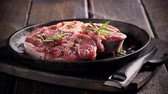 raro : Grilling fresh piece of red meat with herbs