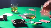 başarı : Dealing cards in a poker on table with a whiskey and cigar