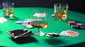 başarı : Smoking a cigar on the table to play poker with whiskey