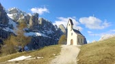 colinas : Path to small church at Passo Gardena in the Dolomites Mountains, South Tyrol, Italy Stock Footage