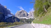 selva : View from a speeding car on the winding roads in the mountains, Dolomites, Alps