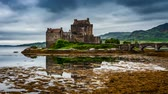 historia : Eilean Donan Castle with tide on lake in Scotland, 4k, timelapse Wideo