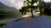 britský : Beautiful sunset over the lake in the Lake District with sunbeam through the tree, England Dostupné videozáznamy