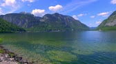 деревня : Mountain Lake in Hallstatt and clouds on a sunny day, Alps Стоковые видеозаписи