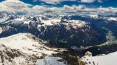 skály : View of the valley from the top of Sass Pordoi peak, Dolomites, 4k timelapse