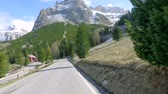 curva : Driving through the serpentine from the peak to down in Dolomites, Italy