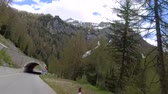 selva : Driving a car on the serpentine through the tunnel to Santa Lucia in the Dolomites, Italy