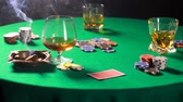 başarı : Dealing cards in a poker on table with a cigar and whiskey Stok Video