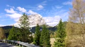 sella : Driving a car on winding road in the Dolomites in spring, Italy Stock Footage