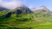 británie : Sunrise over the mountains of Glencoe in spring, Scotland Dostupné videozáznamy