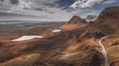 reino unido : Dynamic sky over brown valley in mountain Quiraing, Scotland, United Kingdom,  timelapse