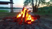 огонь : Campfire by the lake in summer at sunset