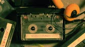manyetik : Spinning cassette tape  and a few old cassettes