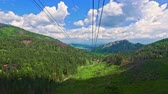 топ : Travel by cable car from Kasprowy Wierch in the summer, Tatras