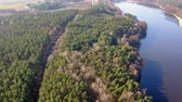 asfalt : Aerial view from above of forest road and one lake Wideo