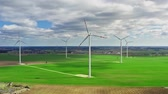 Wind turbines with blue sky on green field, aerial view Stock Footage