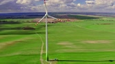 elektrizität : Aerial view of wind turbine on green field in spring