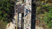 engenharia : Aerial view of a highway construction site, construction of a bridge over the river