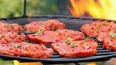 Pork neck with spices on a hot grill with fire, Poland Stock Footage