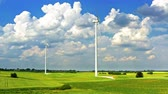 Wind turbines on green field with blue sky, aerial view in Poland