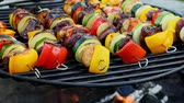 Homemade and tasty skewers on grill with meat and vegetables in summer