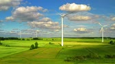 Aerial view of wind turbines with blue sky on green field , Poland Stock Footage