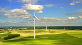 Wind turbines and sky on green field with blue, aerial view, Poland Dostupné videozáznamy