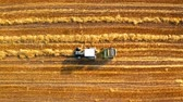 farming machinery : Top view of machines for collecting and pressing hay Stock Footage