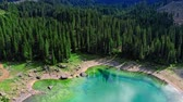 Majestic aerial view of Carezza lake in Dolomites